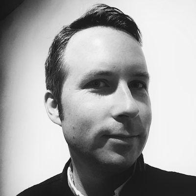 Black and white photo of Tom Goskar