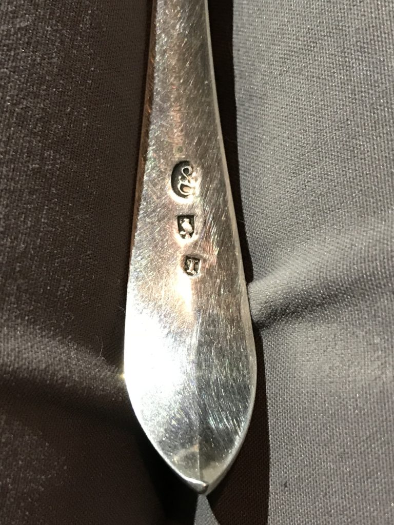 Reverse handle of a silver slotted ladle from the 18th century.