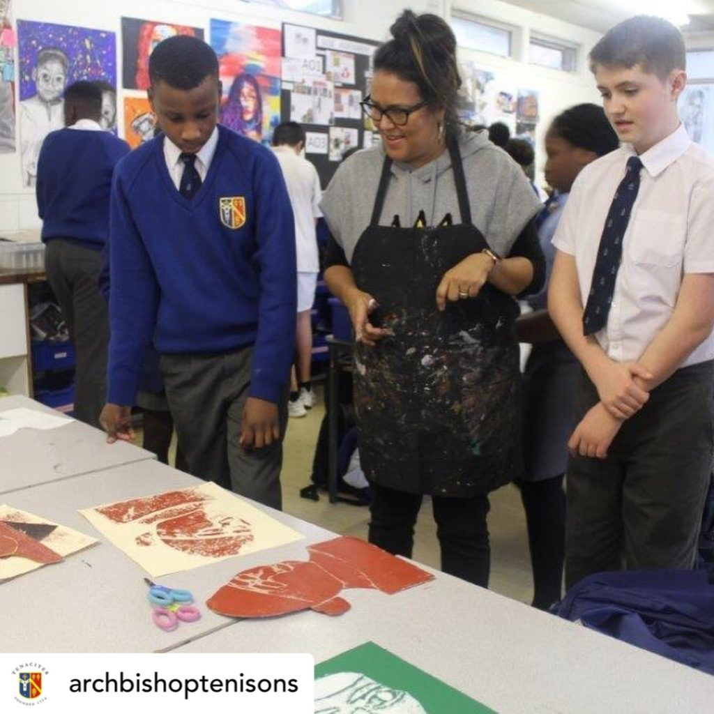 Two pupils and art educator in action
